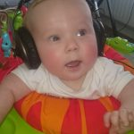 a baby with headphones